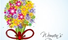Beautiful colorful flowers, red ribbon on occasion of Women's Day
