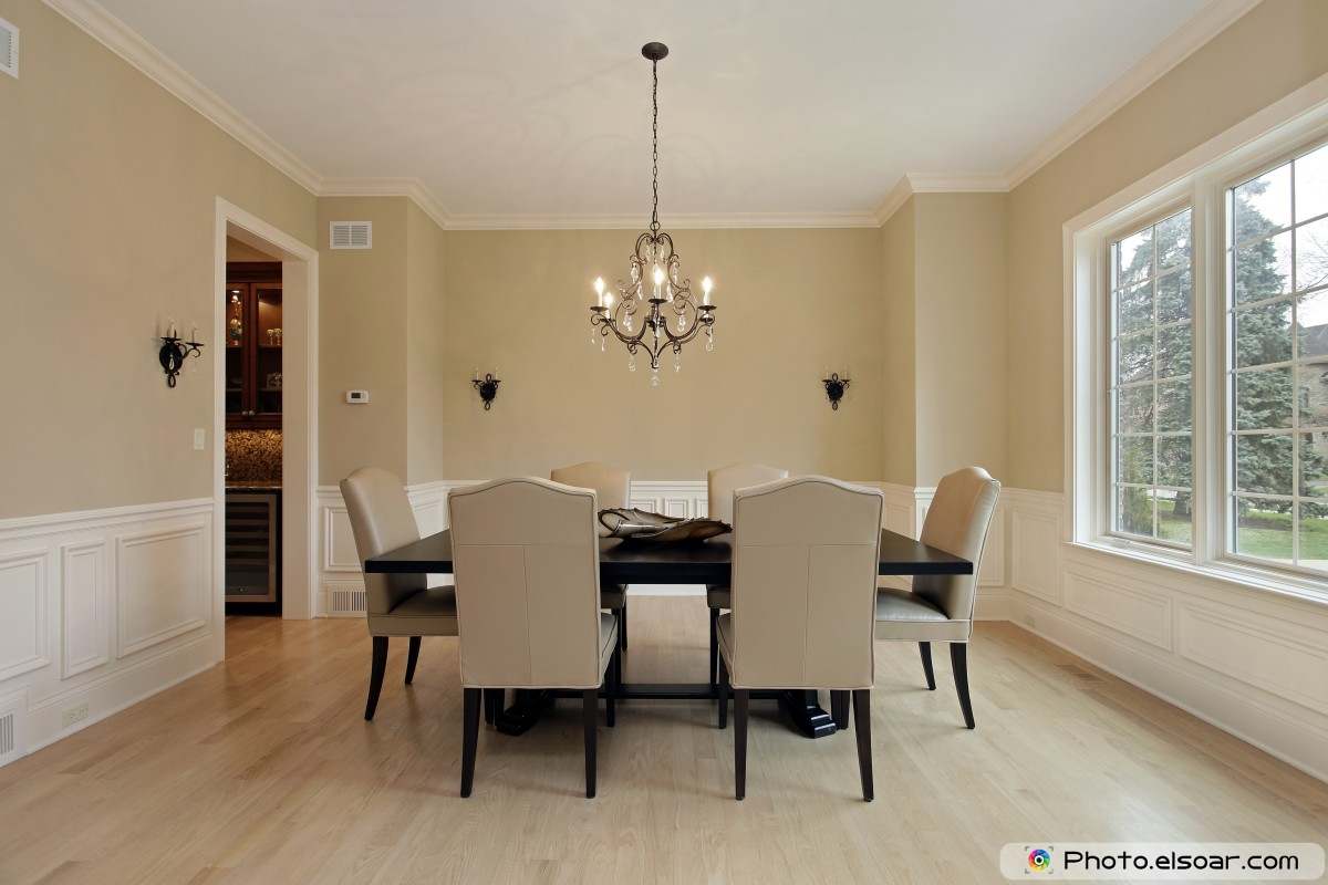 Candle Sconces In A Dining Room