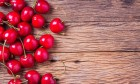 Cherries Close Up On Wooden Table