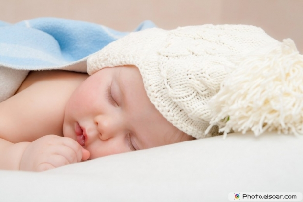 Cute sleeping baby in knitted hat