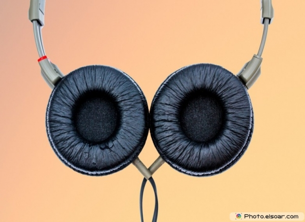 Headphones on an orange background