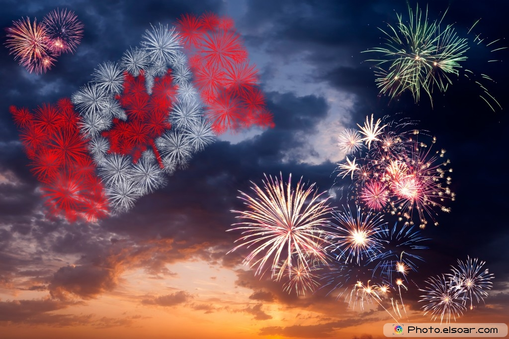Holiday fireworks with national flag of canada