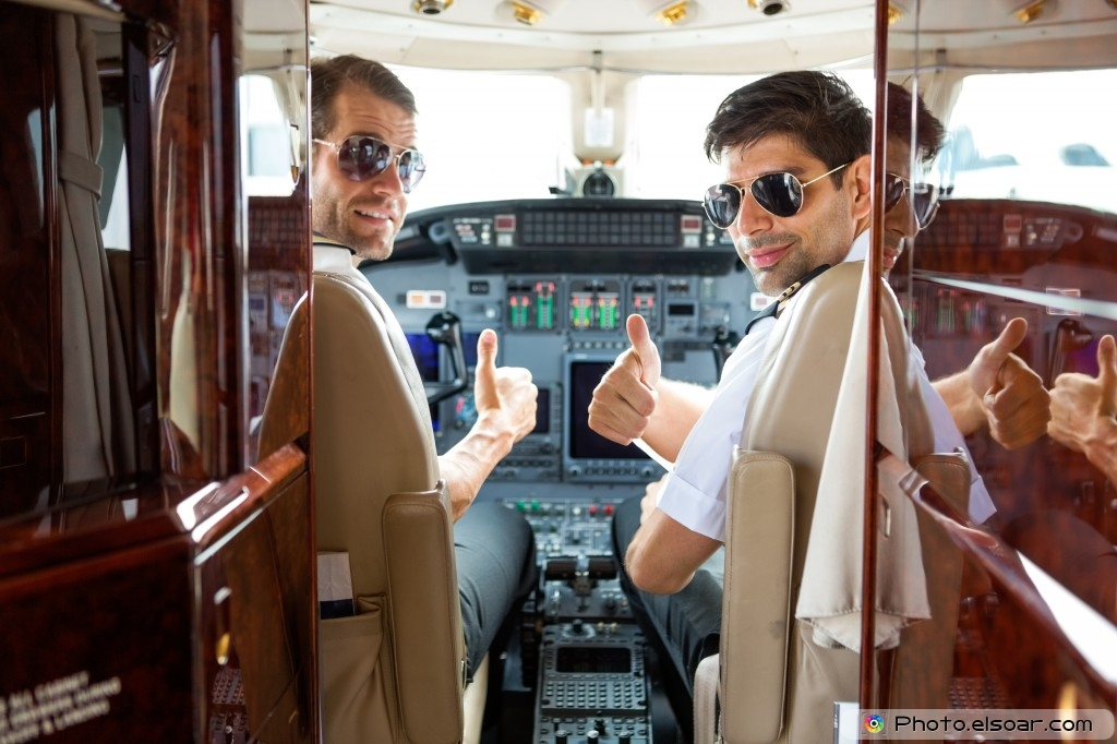 Pilots In Cockpit Of Private Jet