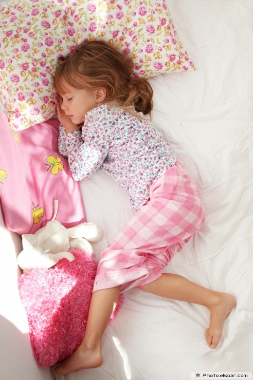 Portrait of child sleeping in bed