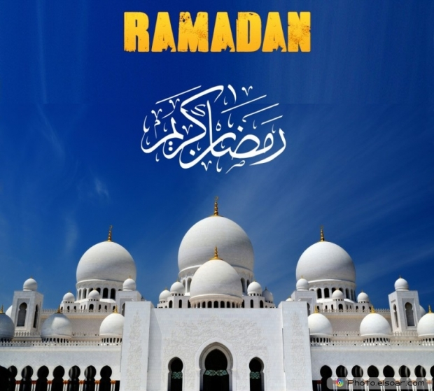 Ramadan Mubarak with mosque on blue sky