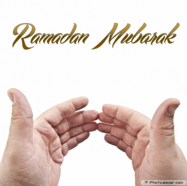 Ramadan Mubarak with muslim hand