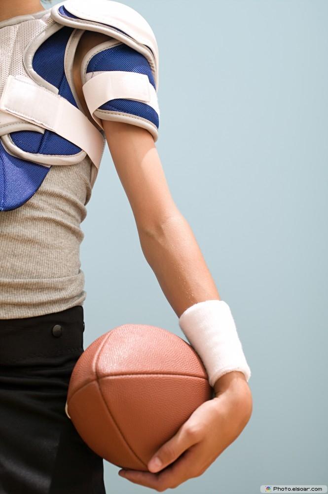 Teenage Boy Holding An American Football