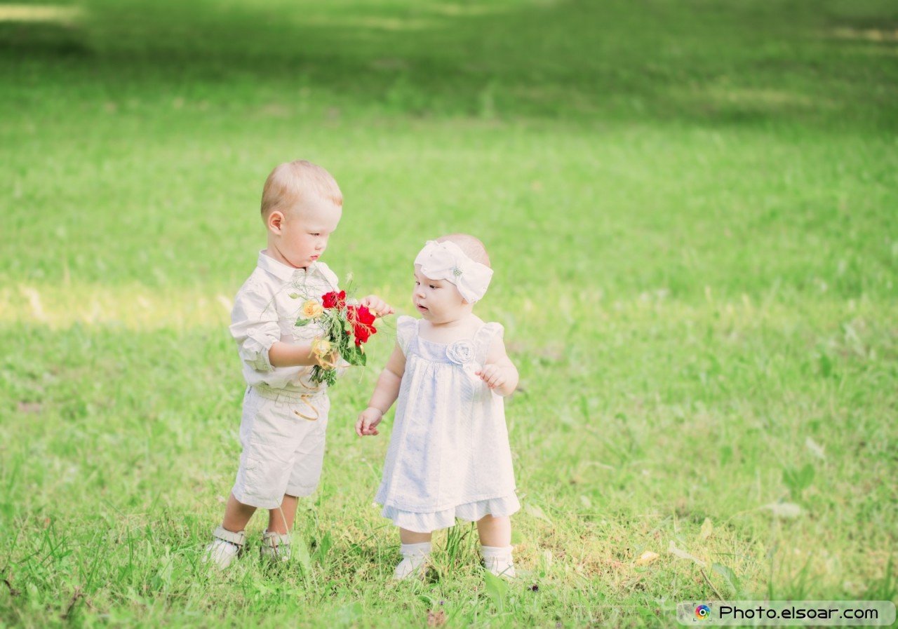 Two little children in summer park