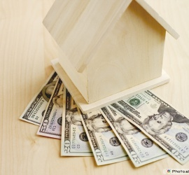 Wooden House With US Currency