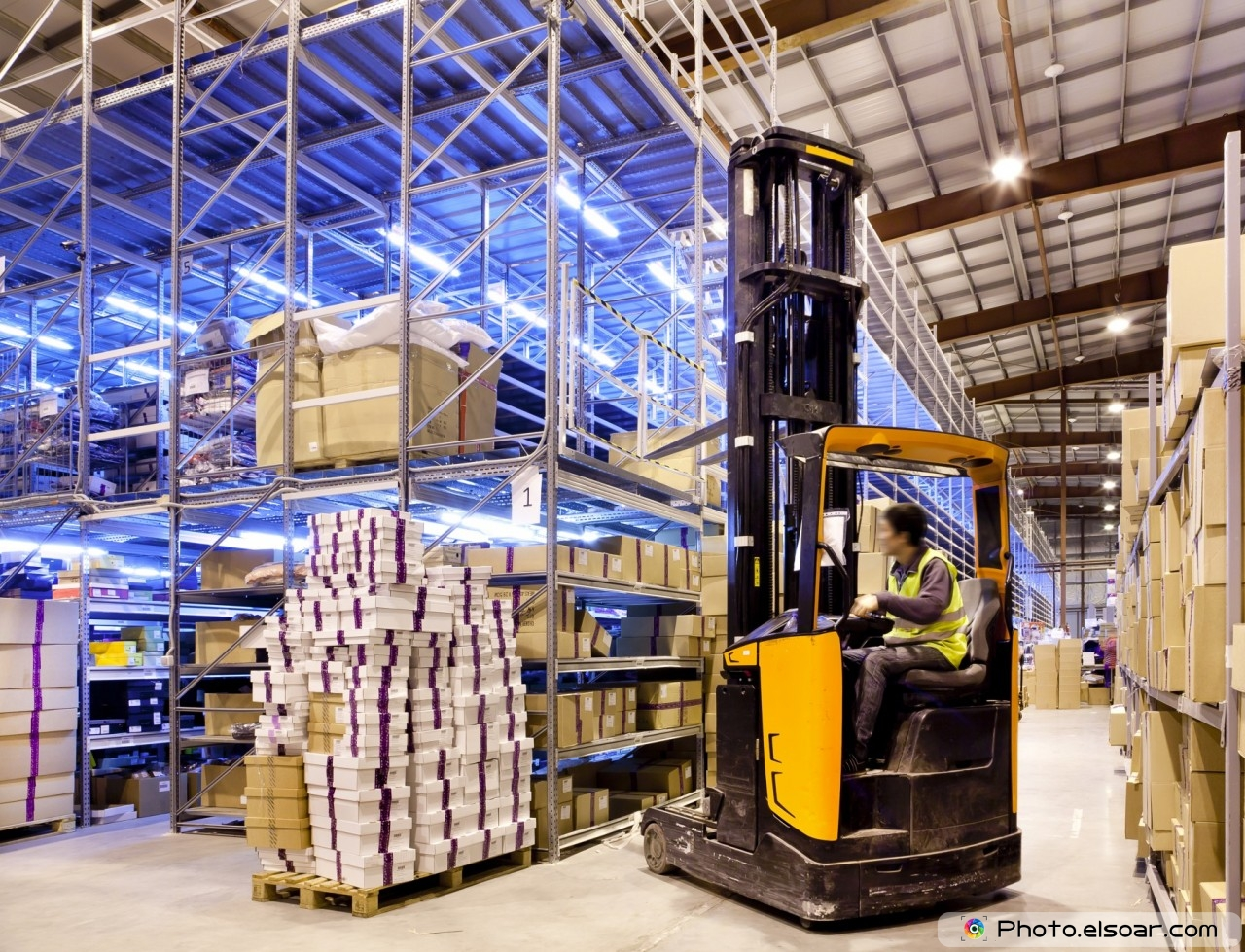 Worker in the motion on forklift