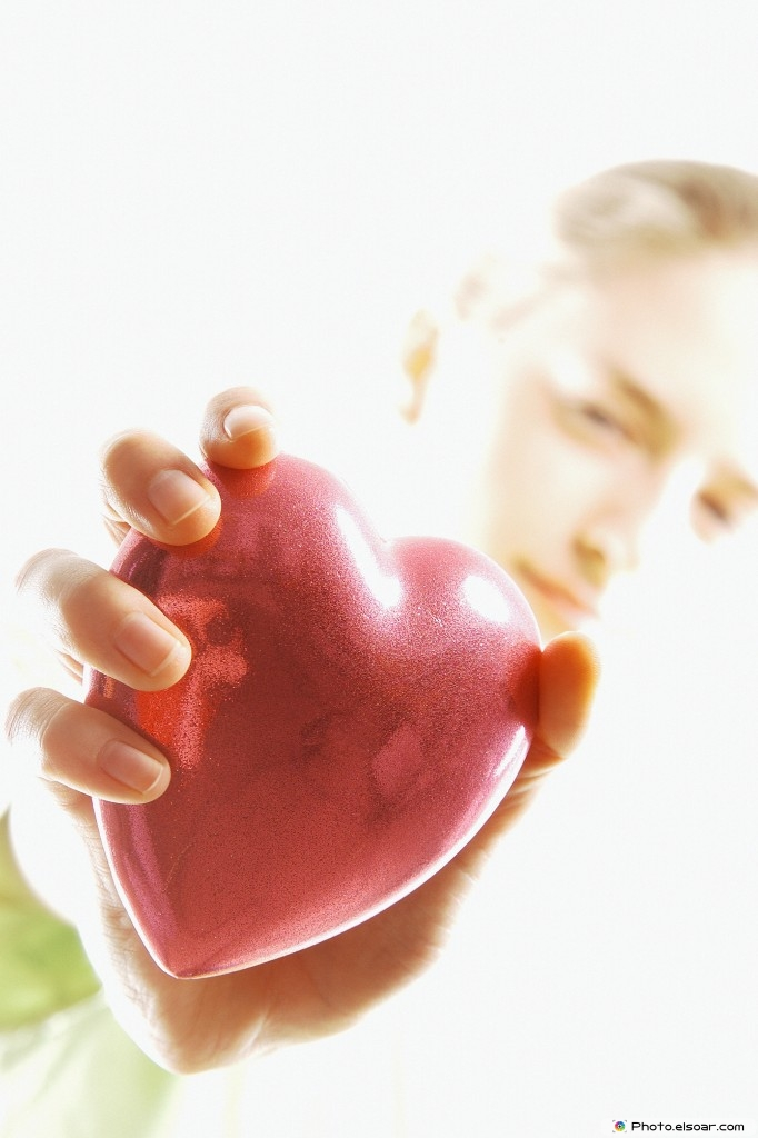 Young Woman Holding Heart Shape
