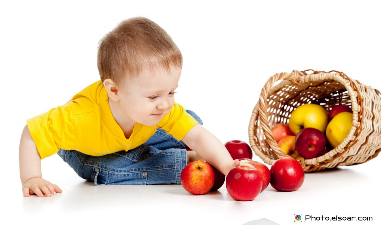 Young boy with apple in basket