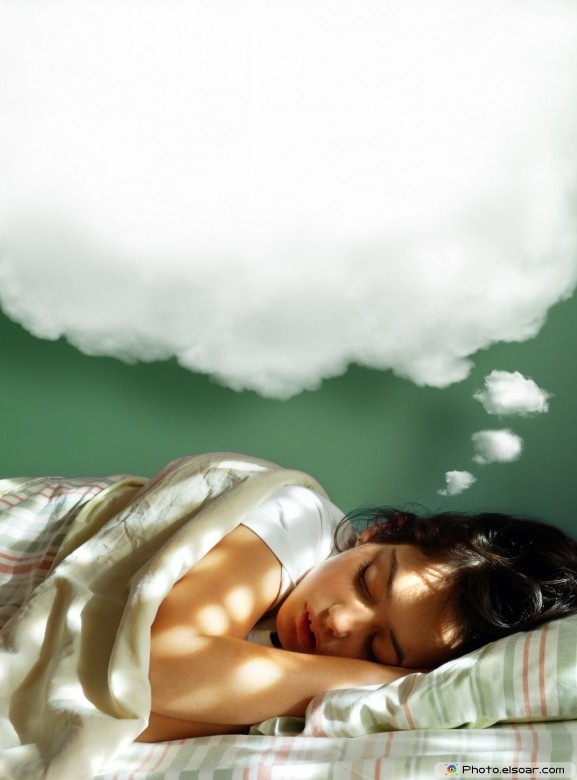 Young girl sleeping in her bed, with fluffy balloon