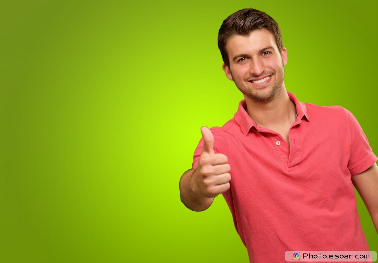 Young man smiling with thumbs up